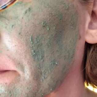 Application of the Lush Love Lettuce face mask.